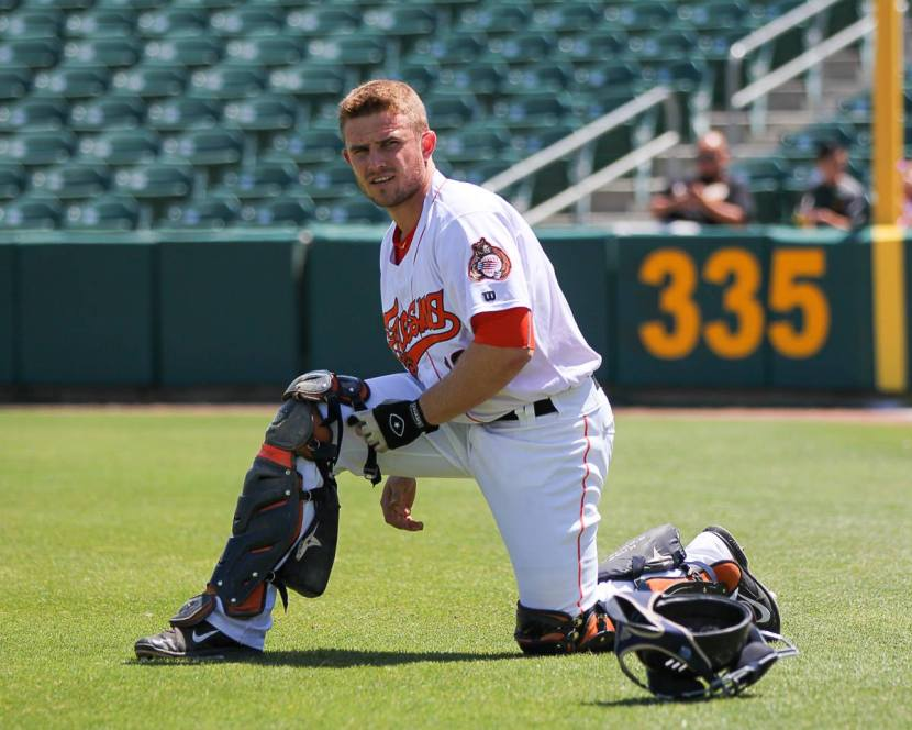 Stassi straps on the gear prior to a Sunday day game at Chukchansi Park (photo by James Ramirez)